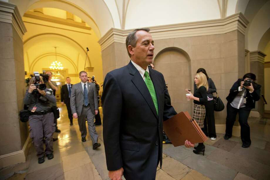 House Speaker John Boehner Ohio walks to his office on Capitol Hill in Washington, Tuesday, Jan. 1, 2013, as legislation to negate a fiscal cliff of across-the-board tax increases and sweeping spending cuts moves to the GOP-dominated House following a bipartisan, middle-of-the-night approval in the Senate. Boehner is expected to encounter opposition from conservatives within his own party. (AP Photo/J. Scott Applewhite) / AP