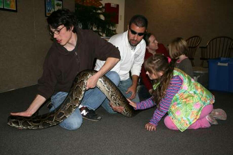 Meet the snakes at Earth Place