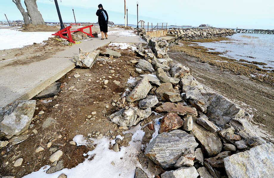 Damage from Hurricane Sandy is still apparent at Calf Pasture Beach Tuesday where the parts of the seawall remain. Hour photo / Erik Trautmann / (C)2012, The Hour Newspapers, all rights reserved