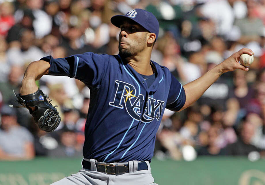 FILE - Tampa Bay Rays starter David Price throws against the Chicago White Sox during the first inning of a baseball game in Chicago, in this Sept. 30, 2012 file photo. The three-time All-Star and the Tampa Bay Rays have agreed to a one-year contract worth just over $10 million, avoiding arbitration a person with knowledge of the deal said Tuesday night Jan. 1, 2013. (AP Photo/Nam Y. Huh, File) / AP
