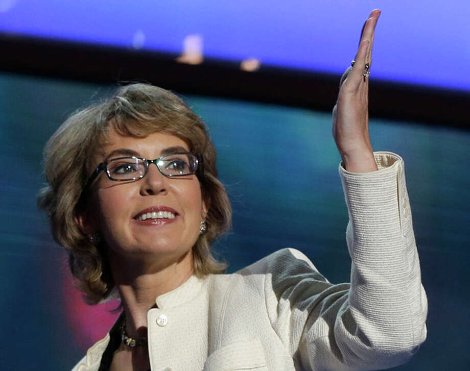 FILE - In this Sept. 6, 2012 file photo, former Arizona Rep. Gabrielle Giffords blows a kiss after reciting the Pledge of Allegiance at the Democratic National Convention in Charlotte, N.C. A spokesman on Thursday, Jan. 3, 2013 said Connecticut's lieutenant governor has been invited to attend a meeting between Giffords and families of the victims of the deadly Newtown elementary school shooting. (AP Photo/Charles Dharapak, File) / AP