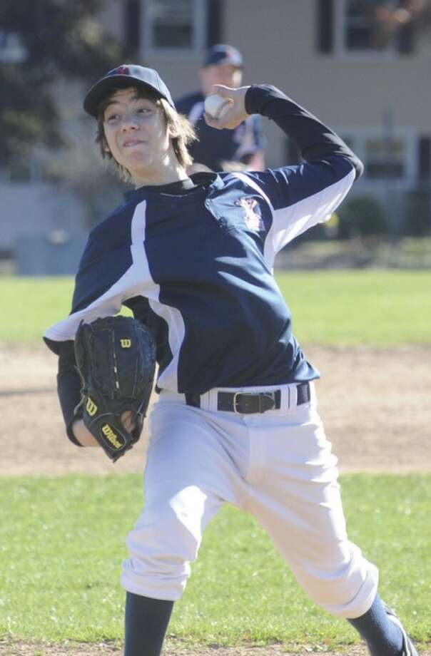 Hour photo/Matthew VinciCC Photo starter Matt Galyas delivers a pitch during the Norwalk Babe Ruth Fall Baseball championship game against Pascarelli Plumbing. Galyas worked six innings in CC's 5-4 victory.