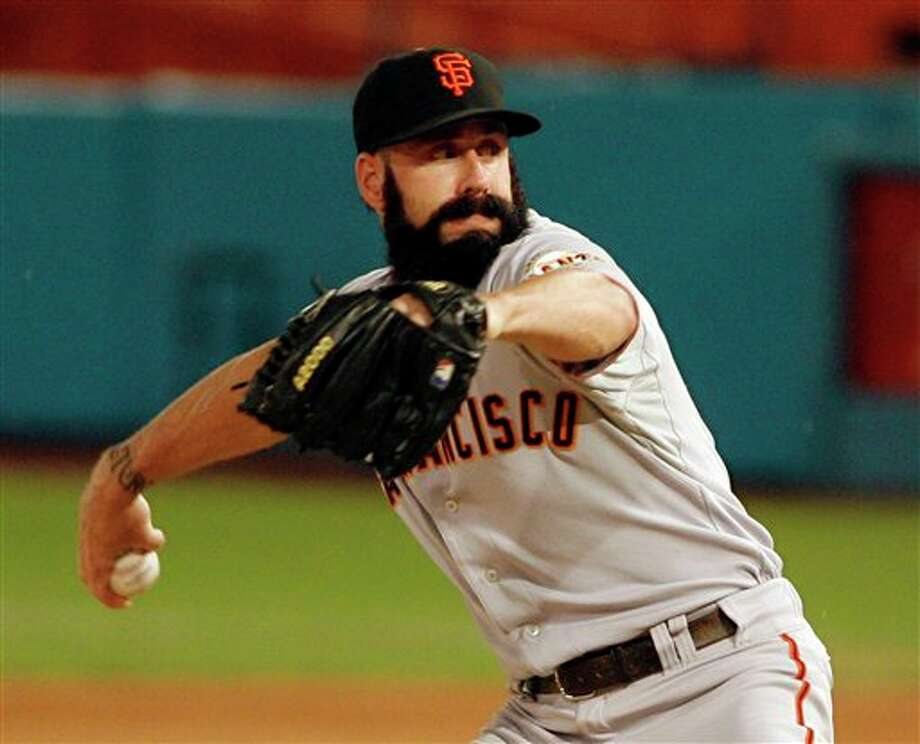 San Francisco Giants' Brian Wilson pitches against the Florida Marlins during the ninth inning of a baseball game on Saturday, Aug. 13, 2011, in Miami. The Giants won 3-0. (AP Photo/Jeffrey M. Boan) / AP2011