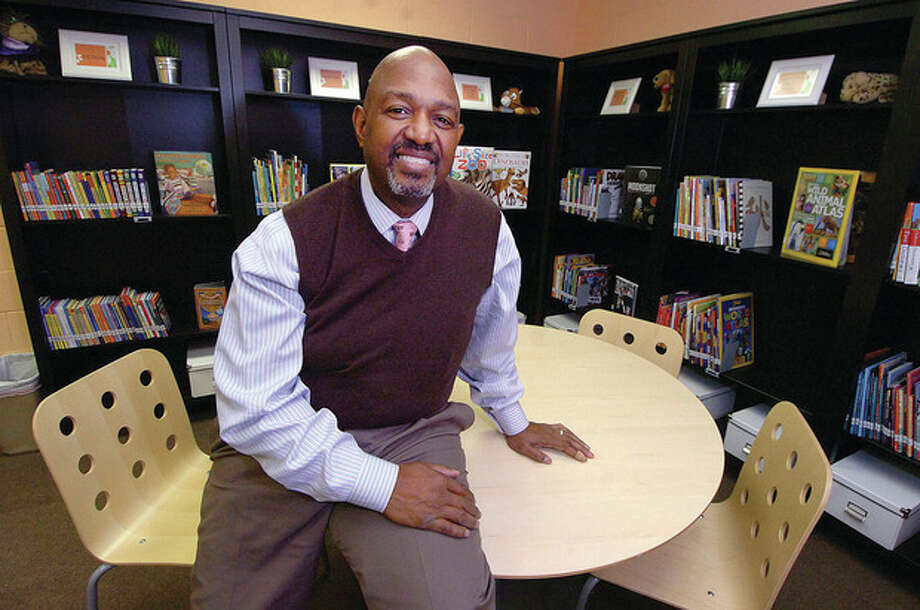 Hour photo / Alex von KleydorffPaul Mayo sits in the library at Grace Baptist Church where he tutors elementary- and middle-school students in math. / © 2012 The Hour Newspapers/Alex von Kleydorff