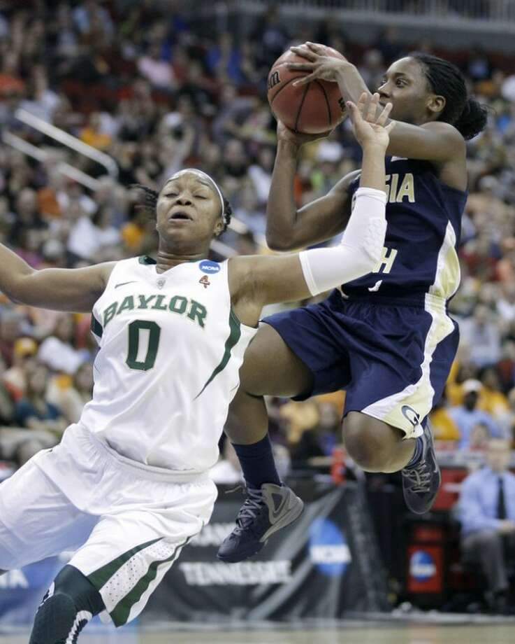 Georgia Tech guard Metra Walthour, right, shoots over Baylor guard Odyssey Sims (0) during the first half of an NCAA women's tournament regional semifinal college basketball game, Saturday, March 24, 2012, in Des Moines, Iowa. (AP Photo/Charlie Neibergall)