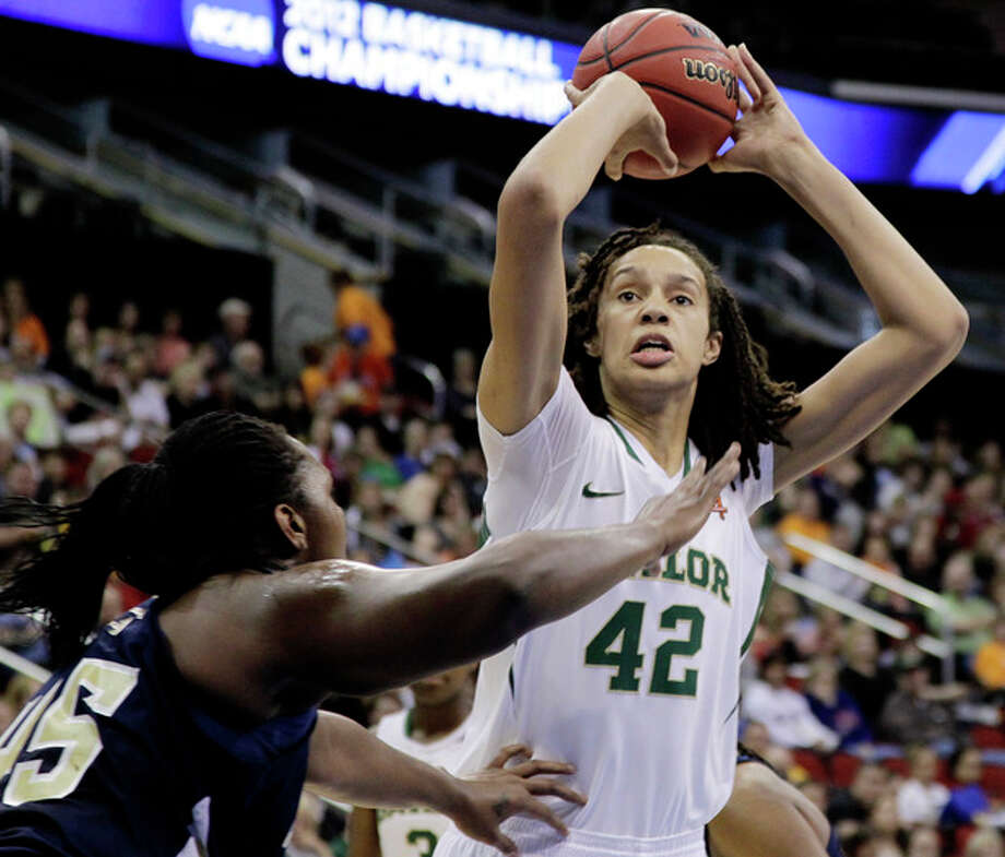 Baylor's Brittney Griner shoots over Georgia Tech's Sasha Goodlett in the first half of an NCAA women's tournament regional semifinal college basketball game in Des Moines, Iowa, Saturday, March 24, 2012. (AP Photo/Nati Harnik)