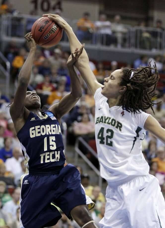 Baylor center Brittney Griner blocks a shot by Georgia Tech guard Tyaunna Marshall (15) during the first half of an NCAA women's tournament regional semifinal college basketball game, Saturday, March 24, 2012, in Des Moines, Iowa. (AP Photo/Charlie Neibergall)