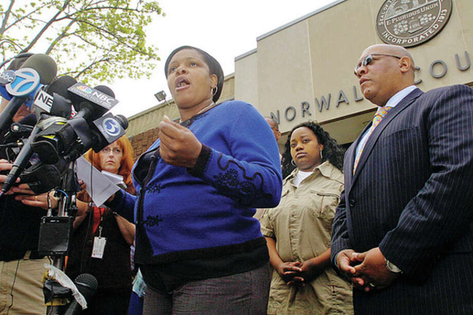 Gwen Samuel, Parent & Founder, CT Parent's Union, comments on the case against Tanya McDowell, who was arrested and charged with larceny and conspiracy to commit larceny for allegedly stealing $15,686 from Norwalk schools after she enrolled her son in the Norwalk Public Schools, during a press conference with Scot X Esdaile, President Connecticut State Conference of NAACP Branches, outside Norwalk Superior Court Wednesday morning.Hour photo / Erik Trautmann / (C)2011, The Hour Newspapers, all rights reserved