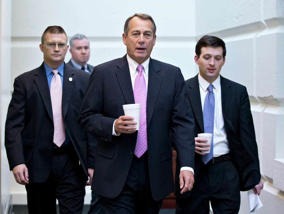 In this Jan. 4, 2013, photo, House Speaker John Boehner of Ohio, walks to a strategy session with GOP members, on Capitol Hill in Washington at the start of the first full day of business for the new 113th Congress. Republicans in Congress who took the politically risky step of voting this week to raise taxes now find themselves trying to fend off potential primary challenges next year from angry conservatives. These lawmakers wasted little time in attempting to deliver an explanation that would be acceptable to the tea party and the GOP's right flank, and, perhaps, insulate themselves from a re-election battle against a fellow Republican. They've started defending the vote as one that preserves tax cuts for most Americans, while promising to fight for spending cuts in upcoming legislative debates over raising the nation's borrowing limit. (AP Photo/J. Scott Applewhite) / AP