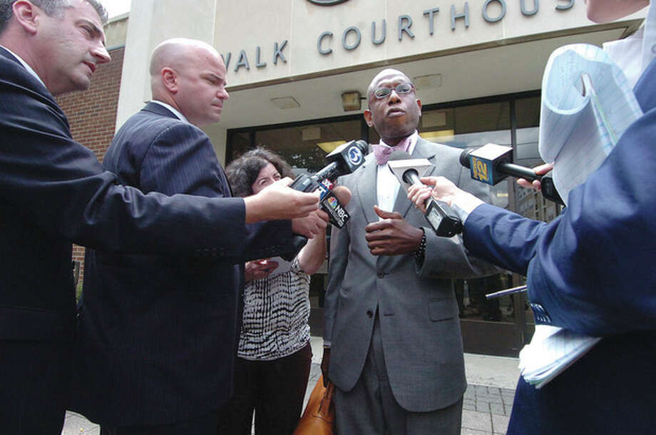 Photo by Alex von Kleydorff. Attorney Darnell D. Crossland speaks to the media outside the Norwalk Superior Courthouse after his client Tanya McDowell was arraigned. / (C)2011, The Hour Newspapers, all rights reserved