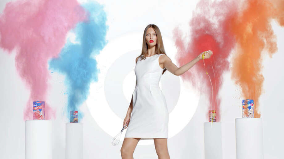This screen grab provided by Target shows an advertisement from the company featuring a model interacting with baking products. Target is pushing its food, laundry detergent and other groceries in a national ad campaign that pokes fun at high-fashion advertising by featuring models interacting with everyday products. (AP Photo/Target) / Target