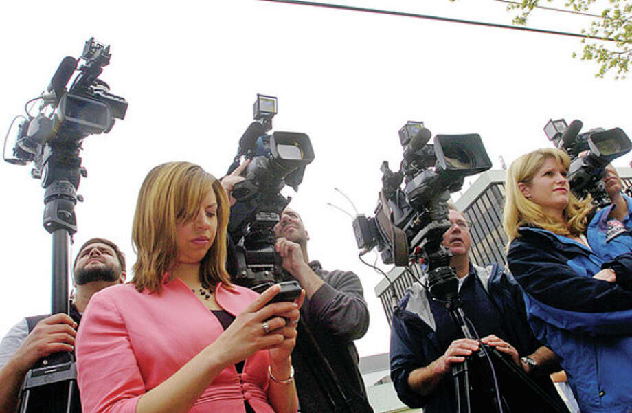 The press gathers for a press conference for Tanya McDowell, who was arrested and charged with larceny and conspiracy to commit larceny for allegedly stealing $15,686 from Norwalk schools after she enrolled her son the Norwalk Public Schools, outside Norwalk Superior Court Wednesday morning.Hour photo / Erik Trautmann / (C)2011, The Hour Newspapers, all rights reserved