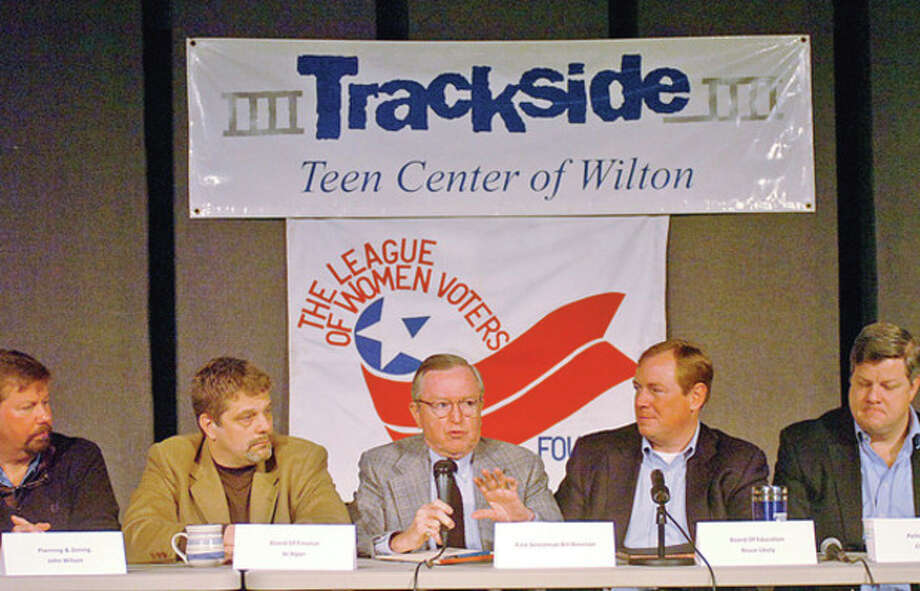 Wilton First Selectman, Bill Brennan, center , answers questions from the audience during the towns annual Speak Up! town meting at the Trackside Teen Center Saturday morning.Hour photo / Erik Trautmann / (C)2011, The Hour Newspapers, all rights reserved