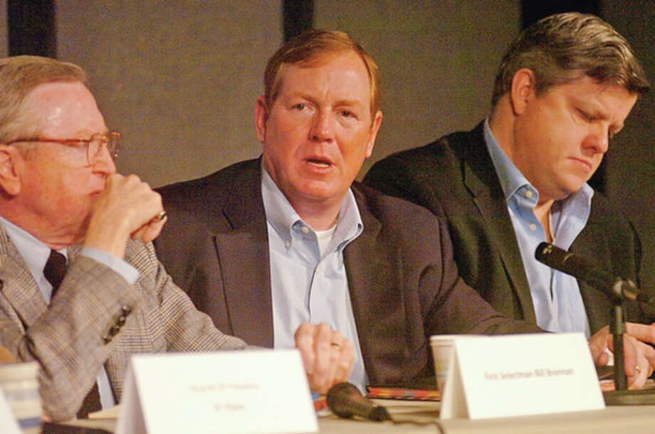 Bruce Likely of the Wilton Board of Education, center, answers questions from the audience during the towns annual Speak Up! town meting at the Trackside Teen Center Saturday morning.Hour photo / Erik Trautmann / (C)2011, The Hour Newspapers, all rights reserved