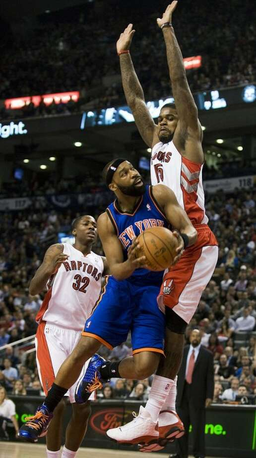 New York Knicks' Baron Davis goes to the net against Toronto Raptors' Amir Johnson during an NBA basketball game in Toronto on Friday, March 23, 2012. (AP Photo/The Canadian Press, Aaron Vincent Elkaim)