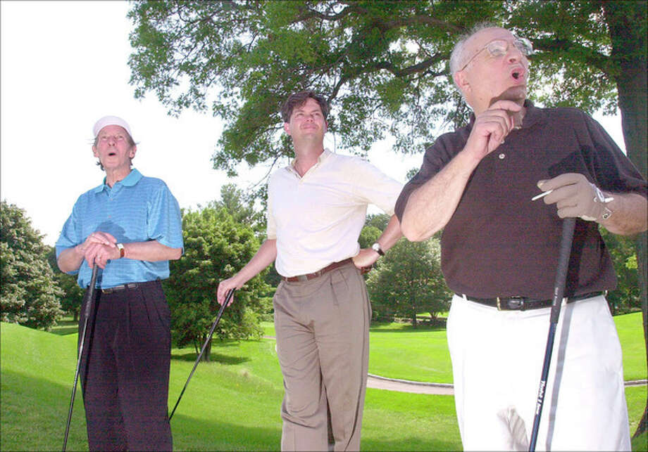 Sheldon Gerarden President of the Chamber of Commerce, Michael Divine, Chairman of the Board and Norwalk Mayor Frank Esposito watch the ball go at the chamber of Commerce golf outing held at the Shorehaven Golf Club in Norwalk on Monday..photo matthew vinci