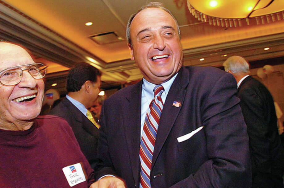 Hour file photo / Erik TrautmannFormer mayor Frank Esposito, left, is shown in this file photo celebrating with State Rep. Larry Cafero, R-142, at the Norwalk Inn on Sept. 2, 2010.