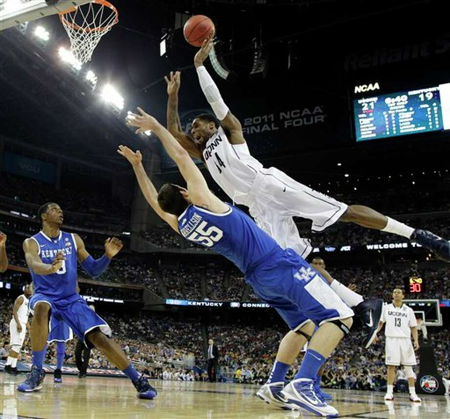 Connecticut's Alex Oriakhi loses the ball as Kentucky's Josh Harrellson defends during the first half of a men's NCAA Final Four semifinal college basketball game Saturday, April 2, 2011, in Houston. (AP Photo/David J. Phillip) / AP2011