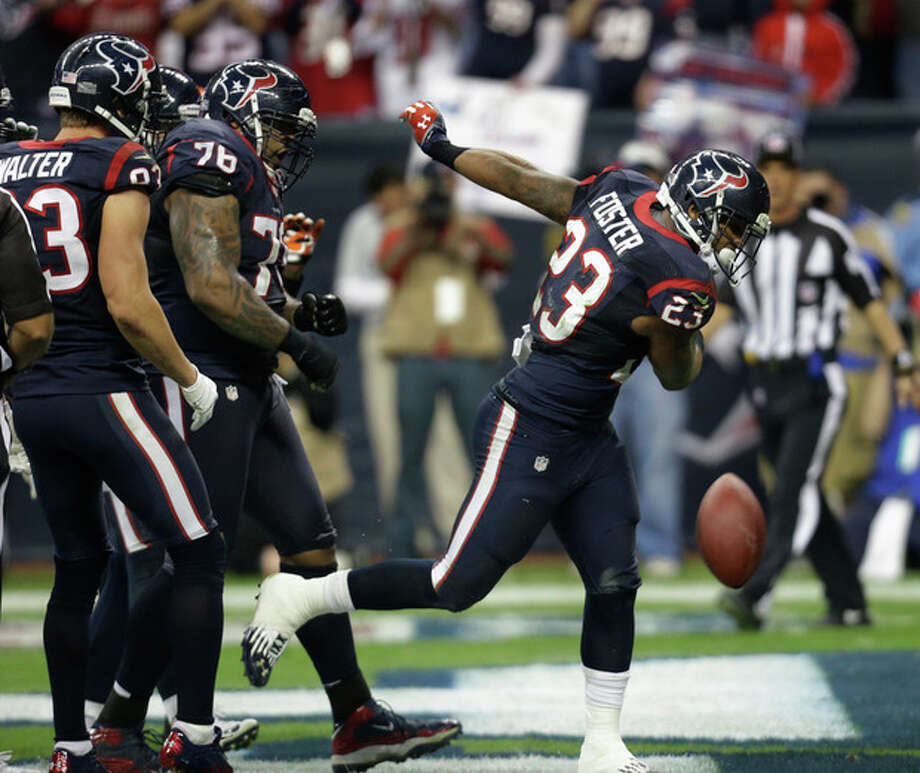 Houston Texans running back Arian Foster (23) celebrates his one-yard touchdown run against the Cincinnati Bengals during the third quarter of an NFL wild card playoff football game Saturday, Jan. 5, 2013, in Houston. (AP Photo/Eric Gay) / AP