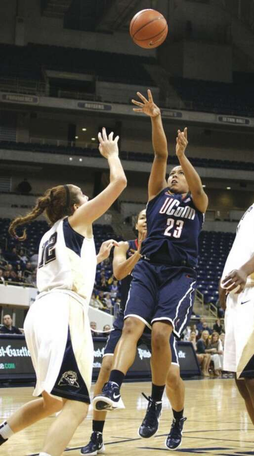 UConn's Kaleena Mosqueda-Lewis shoots over Pitt's Abby Dowd during Tuesday night's game. KML netted 23 points in the Huskies' 86-37 victory.AP Photo