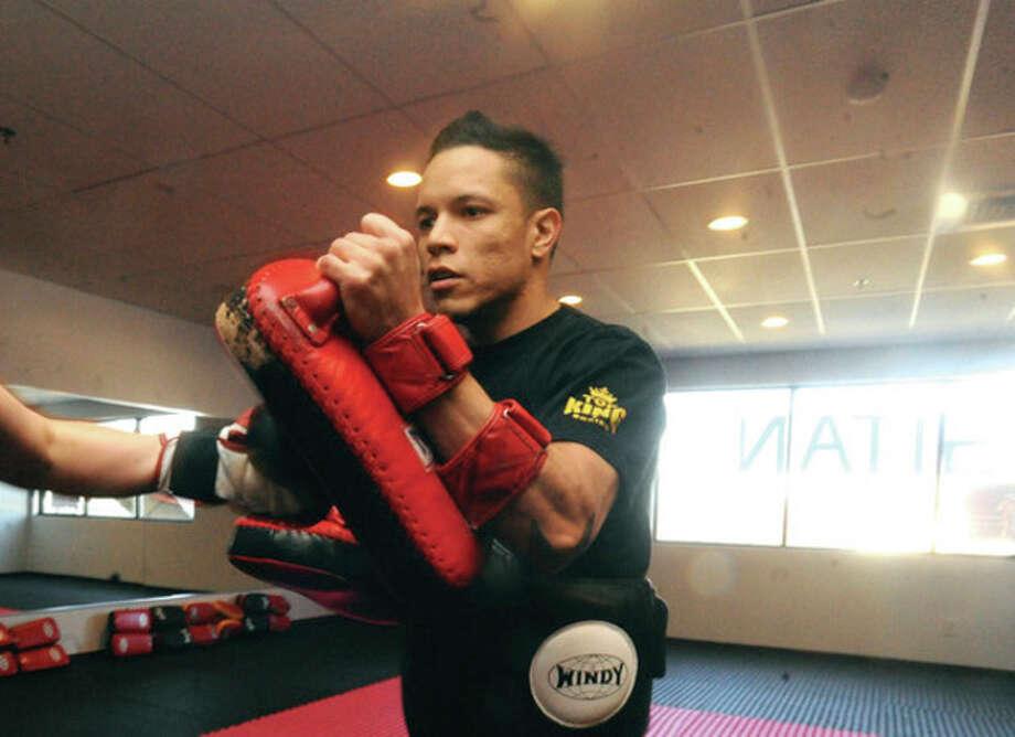 Eddie Martinez, owner and head instructor for the new Sitan Gym in Norwalk demonstrates muay thai kickboxing defense Sunday. hour photo/Matthew Vinci