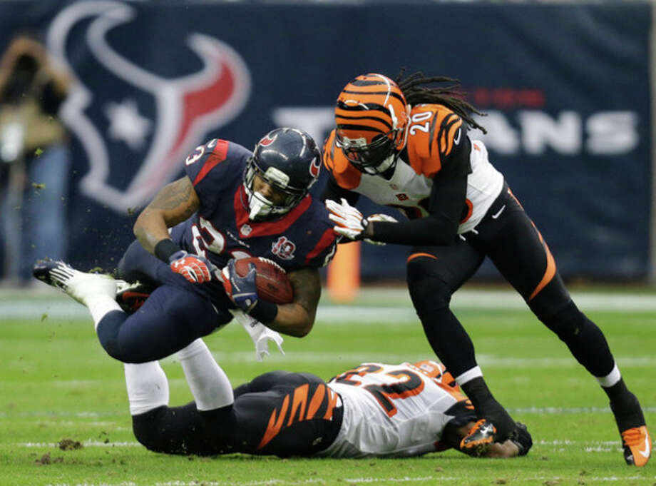 Houston Texans running back Arian Foster (23) is tackled by Cincinnati Bengals free safety Reggie Nelson (20) during the second quarter of an NFL wild card playoff football game Saturday, Jan. 5, 2013, in Houston. Cincinnati Bengals strong safety Nate Clements is underneath Foster. (AP Photo/Eric Gay) / AP