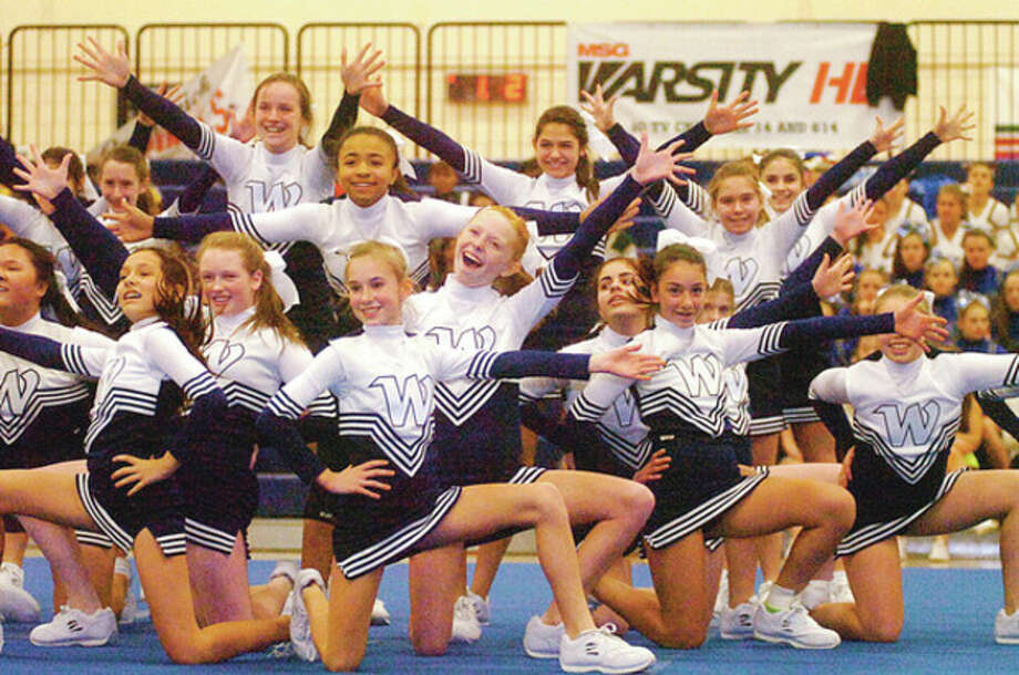 A Wilton Youth Exhibition is performed at the FCIAC Cheerleading Championships Saturday in Wilton.Hour photo / Erik Trautmann / (C)2011, The Hour Newspapers, all rights reserved