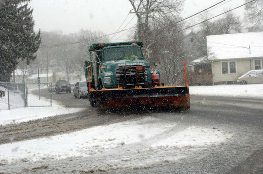 City workers plow Ward Street in Norwalk Wednesday afternoon during the snow storm. Hour Photo / DANIELLE ROBINSON
