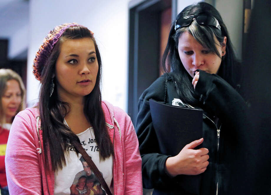 Chantel Blunk, left, leaves with a family member following a preliminary hearing for James Holmes at the courthouse in Centennial, Colo., on Monday, Jan. 7, 2013. Investigators say Holmes opened fire during the midnight showing of the latest Batman movie on July 20, killing 12 people and wounding dozens. Blunk's husband Jon was killed in the shooting. (AP Photo/Ed Andrieski) / AP
