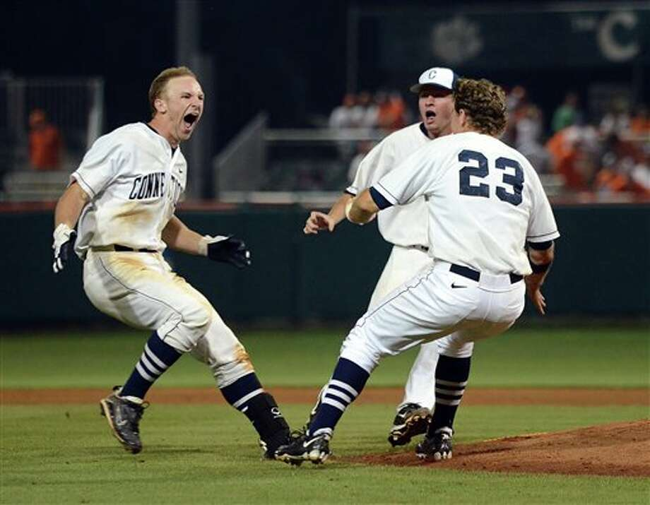 Connecticut's Ryan Fuller (left) and John Andreoli celebrate their 7-6 win over Clemson during an NCAA college baseball regional tournament game against Clemson at Doug Kingsmore Stadium Sunday, June 5, 2011, in Clemson, S.C. (AP Photo/ Richard Shiro) / (2011) Richard Shiro