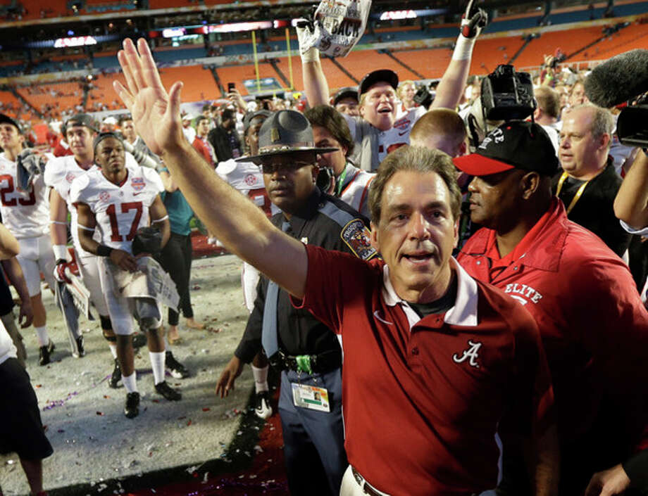 Alabama head coach Nick Saban waves to fans after the BCS National Championship college football game against Notre Dame Monday, Jan. 7, 2013, in Miami. Alabama won 42-14. (AP Photo/David J. Phillip) / AP