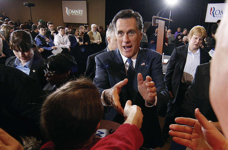 Republican presidential candidate, former Massachusetts Gov. Mitt Romney, greets supporters at his election watch party after winning the Michigan primary in Novi, Mich., Tuesday, Feb. 28, 2012. (AP Photo/Gerald Herbert) / AP