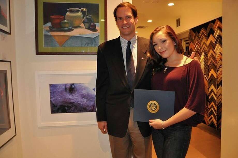 "Contributed photoCongressman Jim Himes and Weston student Olivia Vaccaro pose with Olivia's photograph, ""Self-Portrait,"" that received second place in the 2011 Congressional Art Competition."