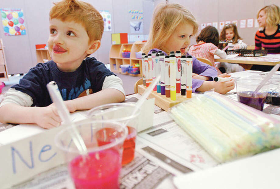 Preschoolers Patrick Neville and Violet Tansley enjoy the first day of the Saugatuck Congregational Church Preschool program in it's new temporary location at the Church of Christ Scientist on South Compo Rd following the fire at Saugatuck Congregational last year. Hour photo / Erik Trautmann / (C)2011, The Hour Newspapers, all rights reserved
