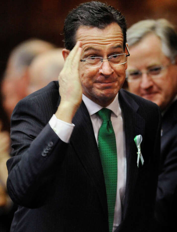 Connecticut Gov. Dannel P. Malloy, salutes as he arrives to speak to the House and the Senate in his State of the State address at the Capitol in Hartford, Conn., Wednesday, Jan. 9, 2013. Gun control, mental health care and school safety are expected to be major topics in the new session. Legislators also must grapple with a projected deficit of about $1.2 billion. (AP Photo/Jessica Hill) / FR125654 AP