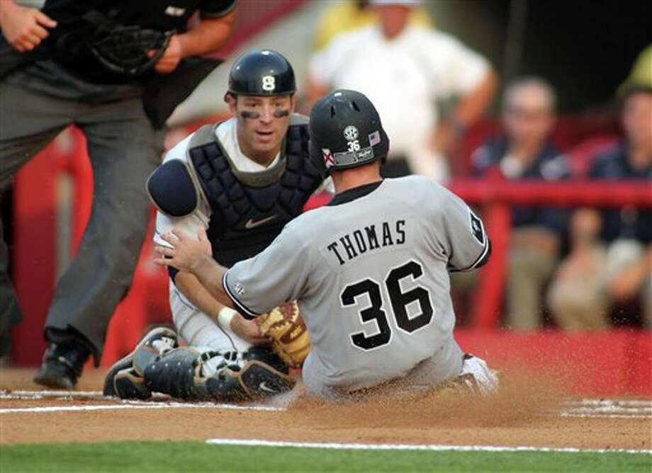 South Carolina baserunner Brady Thomas (36) is tagged out by Connecticut catcher Doug Elliot at home plate in the second inning at the NCAA College Baseball Super Regionals at Carolina Stadium on Sunday, June 12, 2011 in Columbia, S.C. (AP Photo/Willis Glassgow) / fr34287 AP