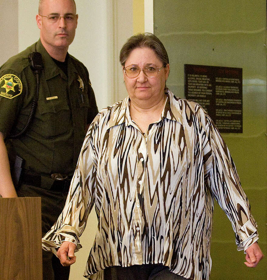 In a Dec. 7, 2011 photo, Sandra Jessee enters an Orange County courtroom in Santa Ana, Calif., where she was found guilty of orchestrating a murder-for-profit conspiracy against her ailing husband, Jack Jessee. Jessee, a California woman, is scheduled to be sentenced to life in prison on Friday March 23, 2012, for having her ailing husband murdered to avoid paying for his cancer treatment and collect on his insurance.(AP Photo/Orange County Register, Jebb Harris) MANDATORY CREDIT, LOS ANGELES TIMES OUT, MAGS OUT / THE ORANGE COUNTY REGISTER, OCREGISTER.COM