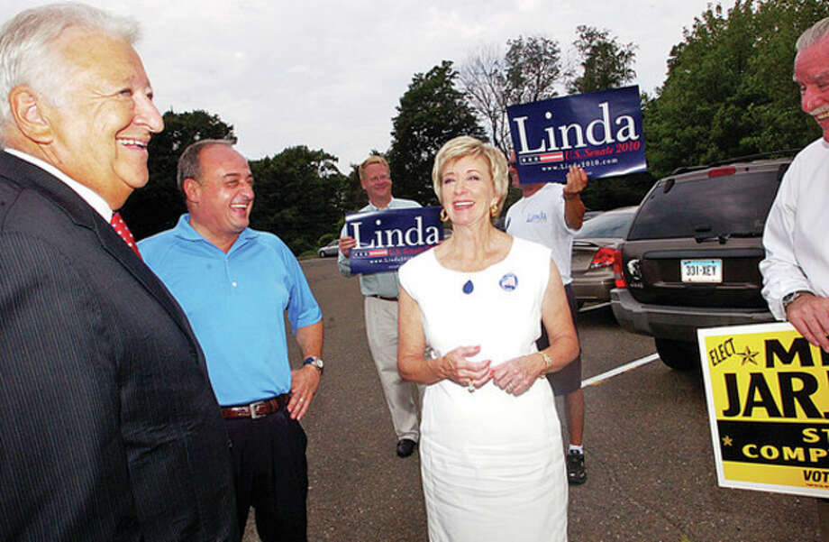 Norwalk mayor Richard Moccia, State Representative Larry Cafero (R-142) share a laugh with GOP Senate hopeful Linda McMahon as she visits Norwalk polling site, Fox Run Elemenatry School, Tuesday. Hour photo / Erik Trautmann / (C)2010 The Hour