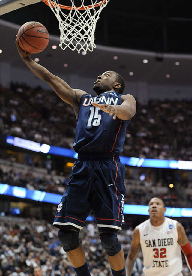 Connecticut's Kemba Walker scores in front of San Diego State's Billy White (32) during the first half of a West regional semifinal in the NCAA college basketball tournament, Thursday, March 24, 2011, in Anaheim, Calif. (AP Photo/Mark J. Terrill) / AP