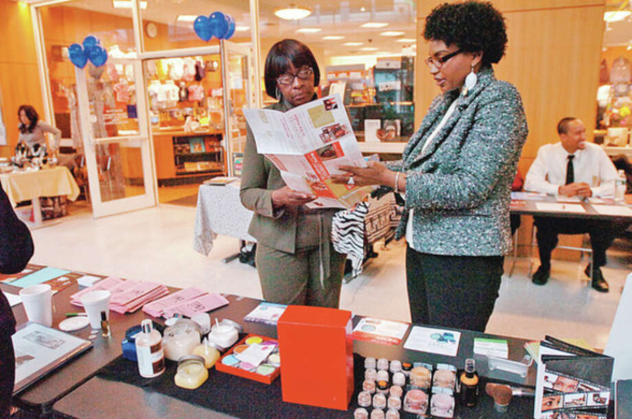 Rosa James looks over cosmetics from Betty Douglas and Soul Purpose Liifestyle at Stamford UCONN Campus during Stamford's 8th annual black history month celebration Wednesday.Hour photo / Erik Trautmann / (C)2011, The Hour Newspapers, all rights reserved