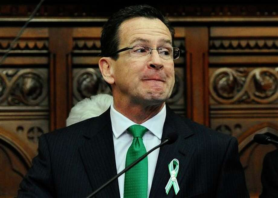Connecticut Gov. Dannel P. Malloy delivers his State of the State address to the House and the Senate at the Capitol in Hartford, Conn., Wednesday, Jan. 9, 2013. Gun control, mental health care and school safety are expected to be major topics in the new session. Legislators also must grapple with a projected deficit of about $1.2 billion. (AP Photo/Jessica Hill) / FR125654 AP