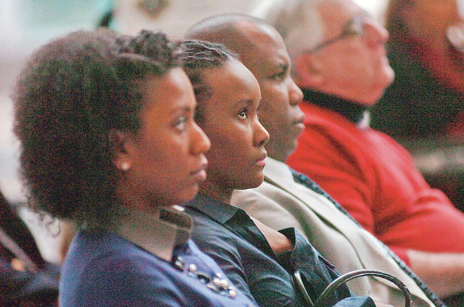 Attendees of Stamford's 8th annual black history month celebration listen to the keynote speaker, Jack Bryant, President of the Stamford NAACP, at the Stamford UCONN Campus Wednesday.Hour photo / Erik Trautmann / (C)2011, The Hour Newspapers, all rights reserved