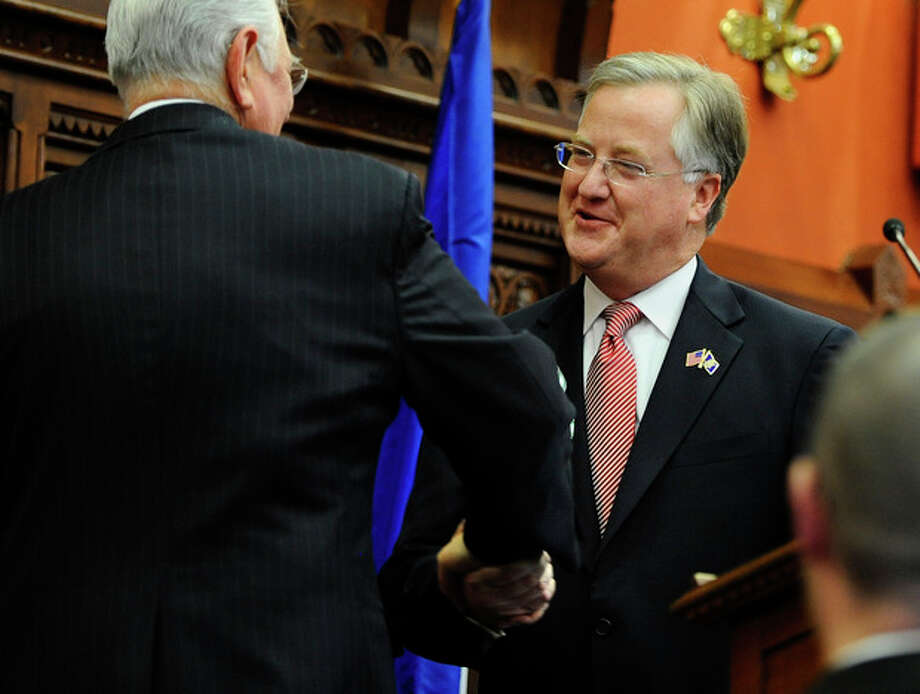 New Speaker of the House Brendan Sharkey shakes hands with Robert Frankel, left, after being sworn in at the at the Capitol in Hartford, Conn., Wednesday, Jan. 9, 2013. Gun control, mental health care and school safety are expected to be major topics in the new session. Legislators also must grapple with a projected deficit of about $1.2 billion. (AP Photo/Jessica Hill) / FR125654 AP