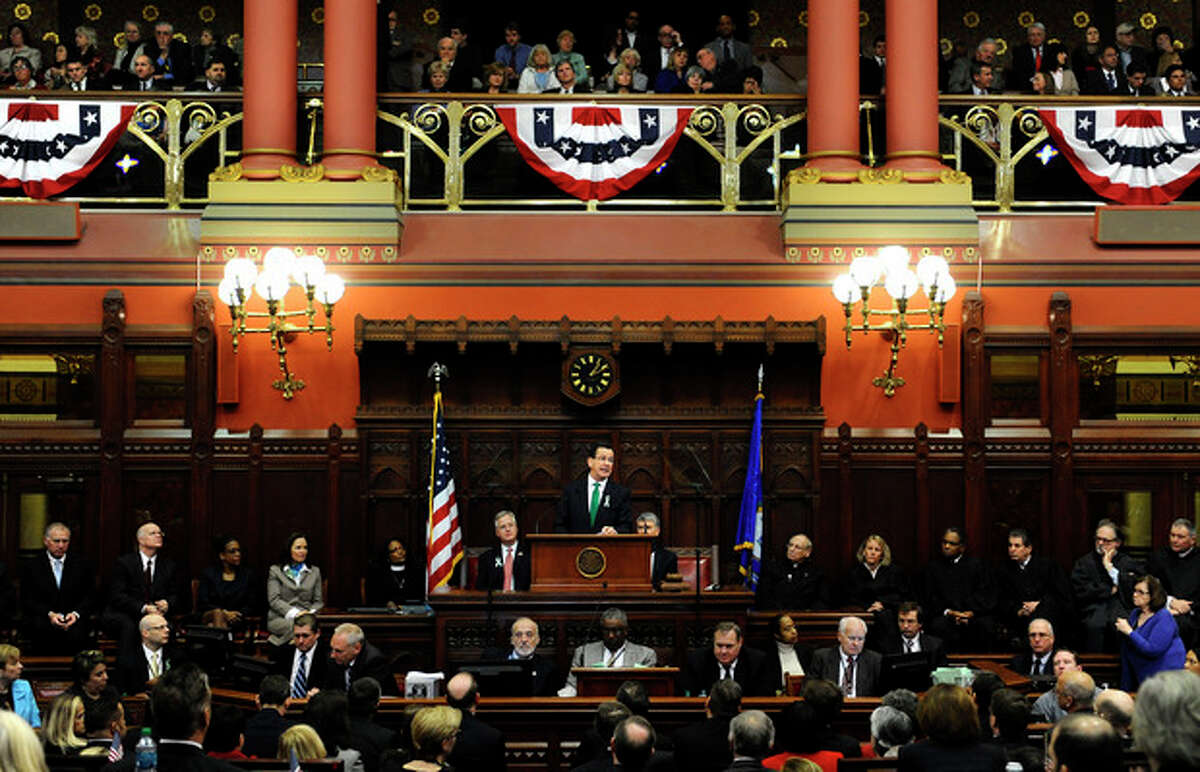 Connecticut Gov. Dannel P. Malloy, center, at podium, speaks to members of the House and the Senate in his State of the State address at the Capitol in Hartford, Conn., Wednesday, Jan. 9, 2013. Malloy urged state lawmakers Wednesday to work with him to prevent future tragedies like the Sandy Hook Elementary School shooting, but stressed that ?