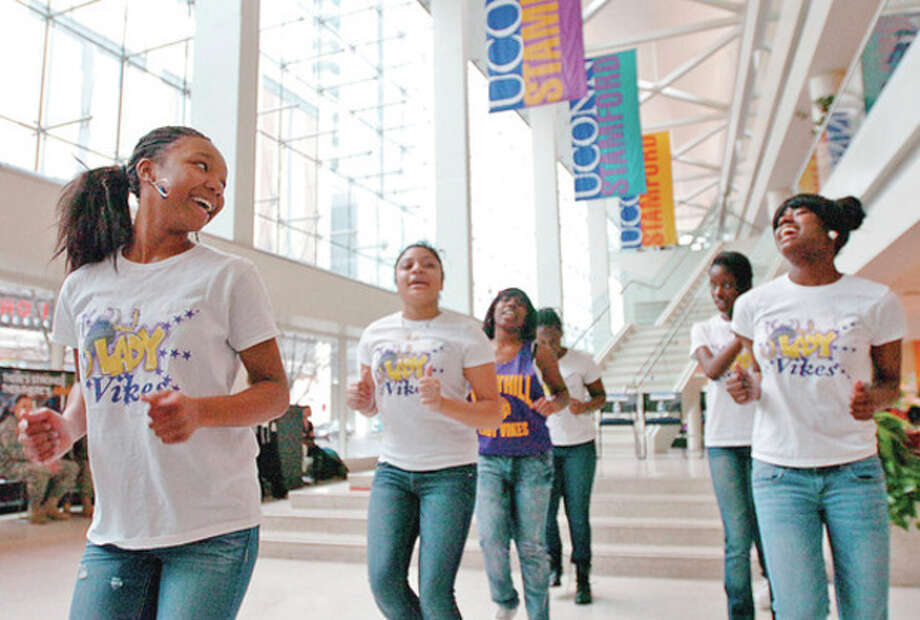 Photo by Erik TrautmannThe Lady Vikes of Westhill High School perform Wednesday at the University of Connecticut, Stamford Campus, during the UConn Stamford Co-op's eighth annual Black History Month celebration. / (C)2011, The Hour Newspapers, all rights reserved