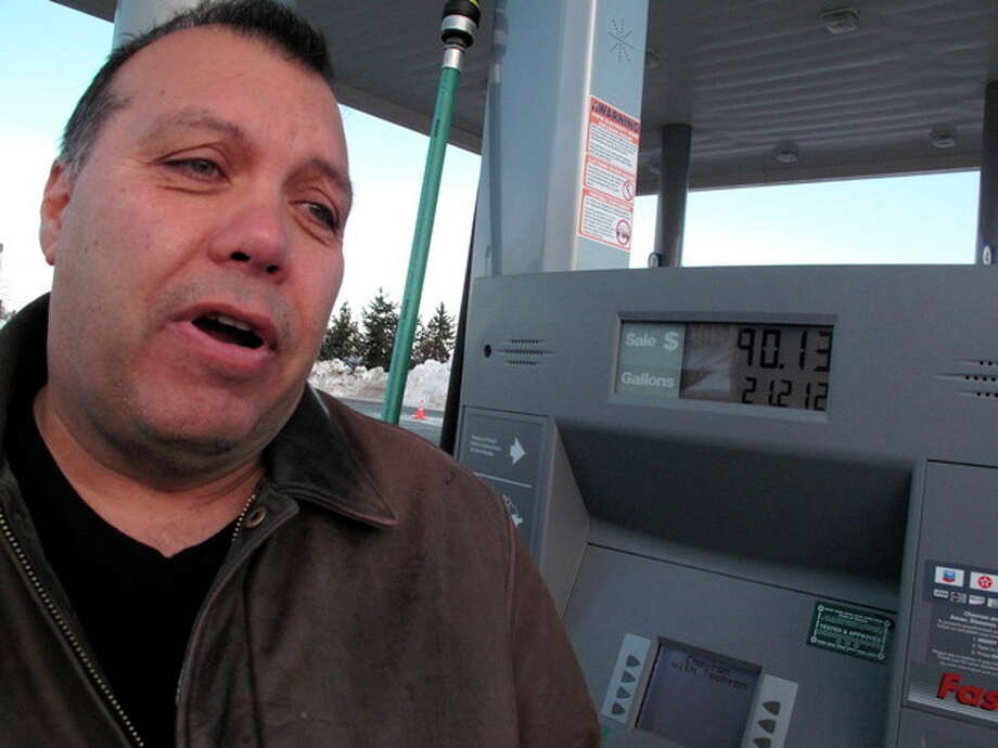 In a Tuesday, March 20, 2012 photo, W.M. Lewis talks about the rising cost of gasoline as he stands in a gas station, in Anchorage, Alaska, where regular unleaded cost as much as nearly $4.25 a gallon. The Anchorage contractor says the steep price has cut down on long commutes. (AP Photo/Rachel D'Oro) / AP