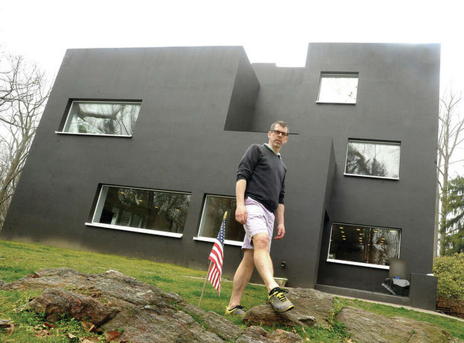 Hour photo / Matthew VinciDoug McDonald, owner of a retrofit passive home in Westport, gave tours on Sunday and explained how his energy-saving installations work.