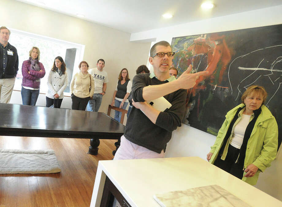 Hour photo / Matthew VinciDoug McDonald, owner of a retrofit passive home in Westport, explains how his energy-saving installations work during a tour of his home Sunday.