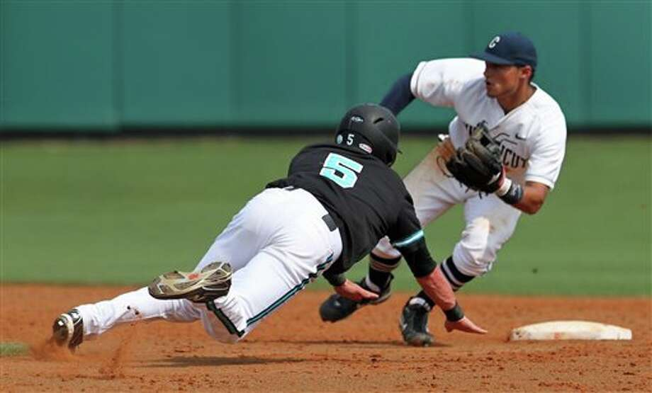 Coastal Carolina's Hayes Orton, left, dives for the bag while stealing second base as Connecticut second baseman L.J. Mazzilli waits for the ball during their NCAA Regional baseball tournament game at Doug Kingsmore Stadium in Clemson, S.C. on Friday, June 3, 2011. (AP Photo/Anderson Independent-Mail, Mark Crammer) / Anderson Independent-Mail