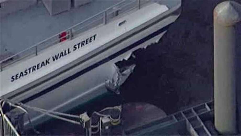 This aerial photo provided by WABC News Channel 7 shows damage to a commuter ferry in Lower Manhattan, Wednesday, Jan. 9, 2013, in New York. The Fire Department says at least 50 people were injured when a ferry from New Jersey struck a dock during rush hour. (AP Photo/WABC News Channel 7) / 2013 AP